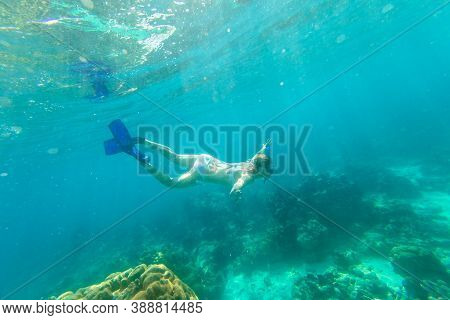 Woman Swimming Deep In Coral Reef Andaman Sea Of Surin Islands. Ko Surin Marine National Park, Under