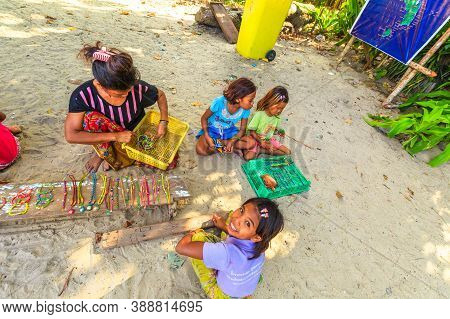 Surin Islands, Ko Phra Thong, Thailand - January 3, 2016: Top View Of Sea Gypsies Family Selling Nec