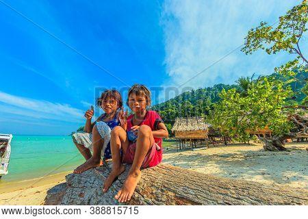 Surin Islands, Phang-nga, Thailand - January 3, 2016: Gypsies Children Sitting In Moken Tribe Villag