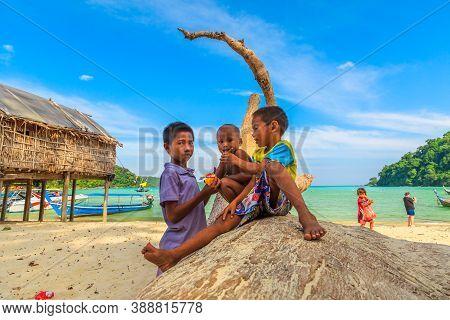 Surin Islands, Ko Phra Thong, Thailand - January 3, 2016: Playful Children On Beach Of Moken Tribe V