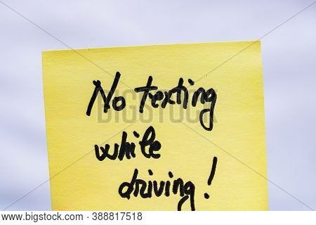 No Texting While Driving Handwriting Text Close Up Isolated On Yellow Paper With Copy Space.