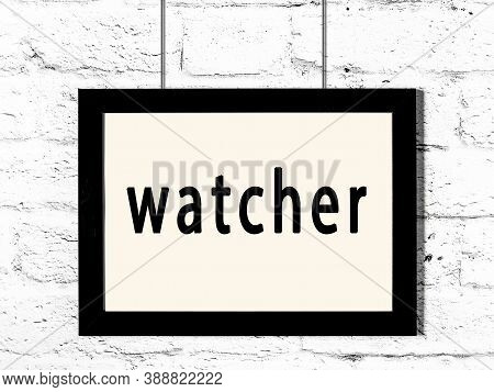 Black Wooden Frame With Inscription Watcher Hanging On White Brick Wall