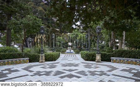 Typical Andalusian Park With Gardens And Fountains