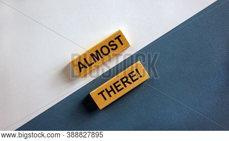 Concept Words 'almost There' On Wooden Blocks On A Beautiful White And Blue Background. Business Con