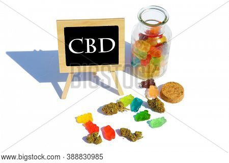 THC  Candies. CBD Edibles. Edible Gummy Bears infused with Cannabis.   Isolated on white. Room for text. Chalk board reads CBD.