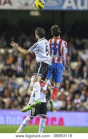 VALENCIA - NOVEMBER 3: Gago & Adrian during Spanish Cup match between Valencia CF and AT Madrid, on November 3, 2012, in Mestalla Stadium, Valencia, Spain