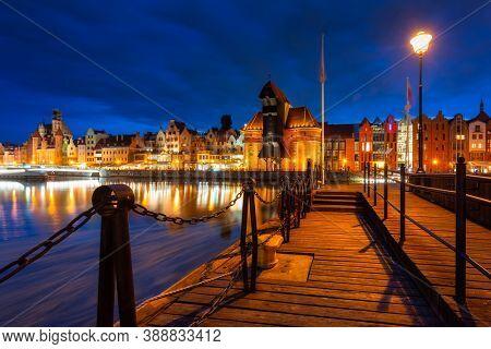 Historical Port Crane over the Motlawa river in Gdansk at dusk,  Poland