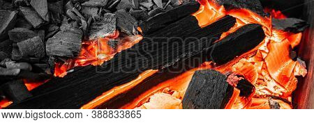 Close-up Of Actively Smoldering Embers. Red Live Coals In Burning Fire. Bonfire On Street. Flame And