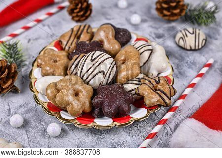 Traditional Gingerbread Cookies With Sugar And Brown And White Chocolate Glazing On Striped Plate Su