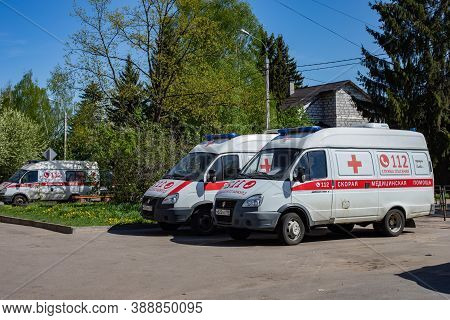 Moscow, Russia - May 11, 2020: White Red Ambulances, Medical Emergency Vehicles. Virus Epidemic And