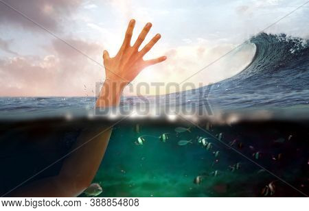 Hand Of Person Drowning In Water At Sea