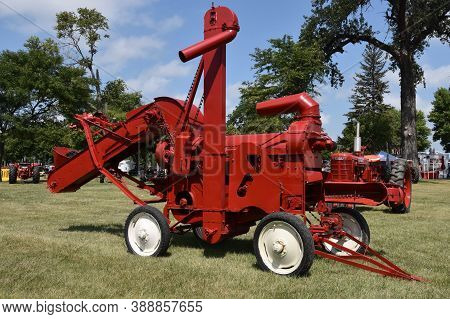 Huron, South Dakota, August 6, 2020: The Restored Red Farmall Threshing Machine Is Displayed At The