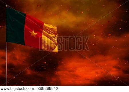 Fluttering Cameroon Flag Mockup With Blank Space For Your Data On Crimson Red Sky With Smoke Pillars