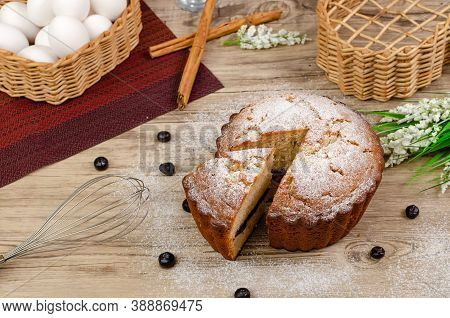 Pound Cake On Wooden Table Decorated With Blueberries Around.
