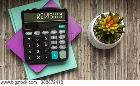 Revision, Text On The Calculator. Colored Notepads And Cactus On Wooden Background