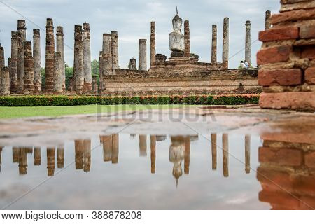 The Scenery Of The Reflection Of The Buddha Statue Inside Wat Mahathat Temple In Sukhothai Historica