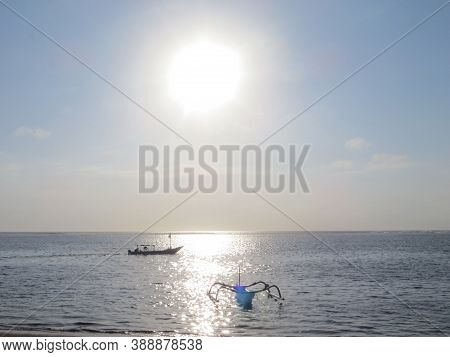 Denpasar, Indonesia - September 29, 2019: Jukung Boats Sailing On The Sea At Mertasari Beach.