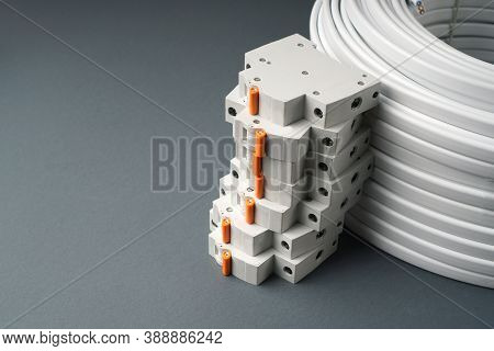 Home Electric Background With Circuit Breakers And Cable. Copy Space.