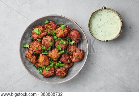 Veg Pakora In Gray Bowl On Concrete Table Top. Pakoda Is Indian Cuisine Appetizer Deep Fried Dish. A