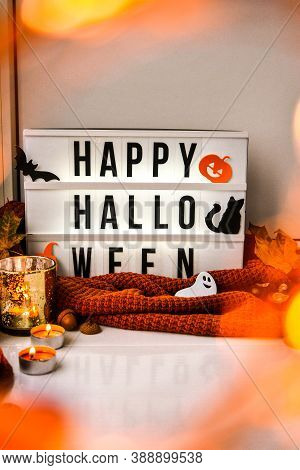 Happy Halloween. Text In White Light Box, With A Background Of Sweater, Dried Leaves Halloween Autum