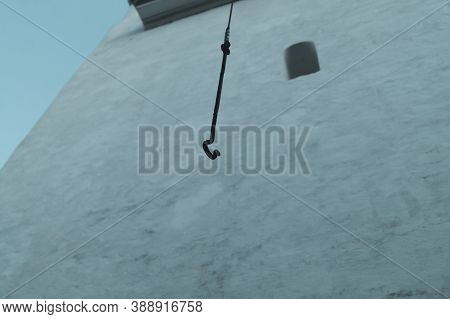 Hook Of The Bell Is Hanging Down On The Rope