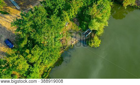 Fishing Place On Shore Of Lake, River, In Green Landscape, Dinghy Boat Is Placed Out Of Water.