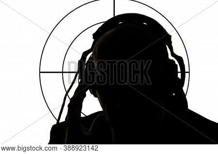 Silhouette Of A Man With Headphones On The Background Of The Target. Concept:secret Agent Eavesdropp