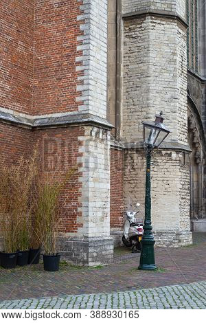 07 October 2020, Leiden, Netherlands, White Vespa, Lamppost And The Hooglandse Church, Late Gothic B