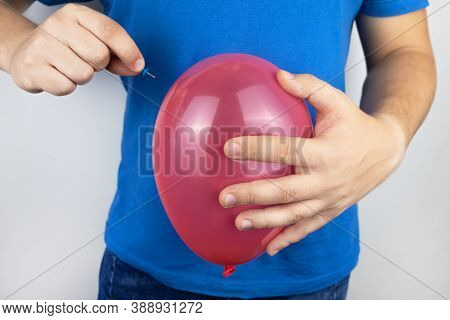 Conceptual Photography. The Man Holds A Red Ball Near His Belly, Which Symbolizes Bloating And Flatu