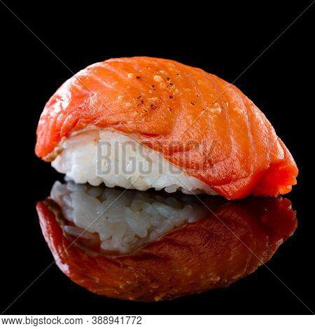 Seared Sushi Nigiri With Salmon, Fine Nigiri Sushi On Black Background With Reflection