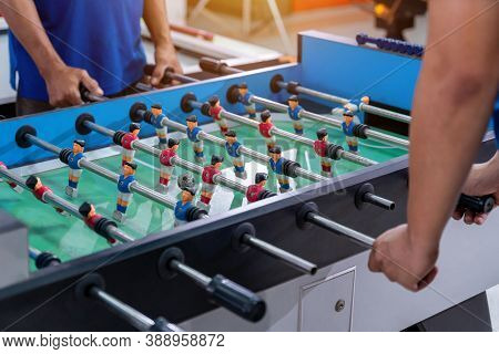 Office Workers Playing An Indoor Soccer World Cup Game During Their Break Time To Relieve Stress In
