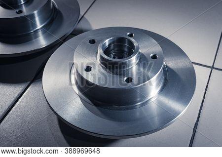 Auto Parts, New Brake Discs Car Service. Close Up