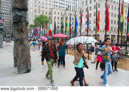 New York, Usa - July 1, 2013: People Visit Rockefeller Center In New York. Rockefeller Center Is One