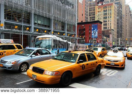 New York, Usa - July 1, 2013: People Ride Yellow Cabs In Midtown Manhattan In New York. As Of 2012 T