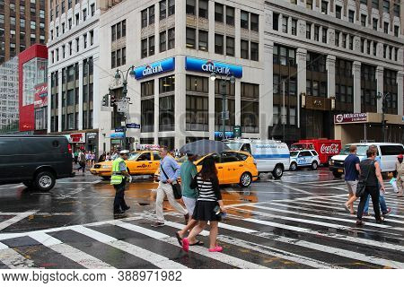 New York, Usa - July 1, 2013: Pedestrians Cross 7th Avenue In New York. Almost 19 Million People Liv