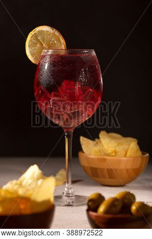 Typical Aperitif With Red Wine And Chips