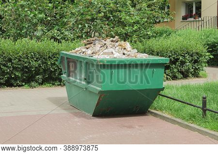 Container With Solid Household And Construction Waste. Waste Recycling. Caring For The Environment