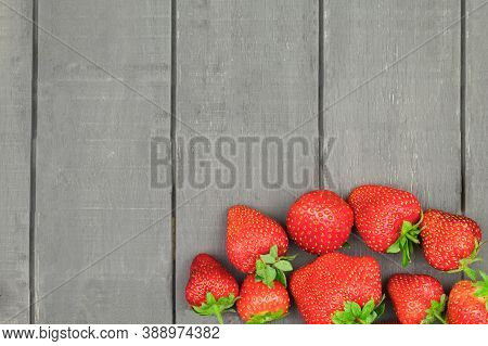 Fresh And Sweet Strawberries Laid Out On A Table On A Dark Background. Juicy And Fresh Strawberries