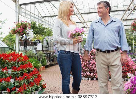 Couple strolling through garen center holding hands