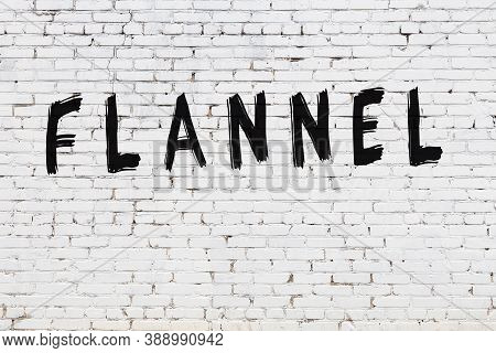 Inscription Flannel Written With Black Paint On White Brick Wall.