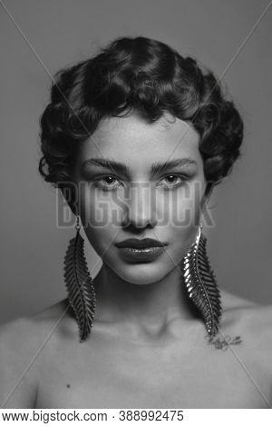 Vintage style black and white portrait of young beautiful woman