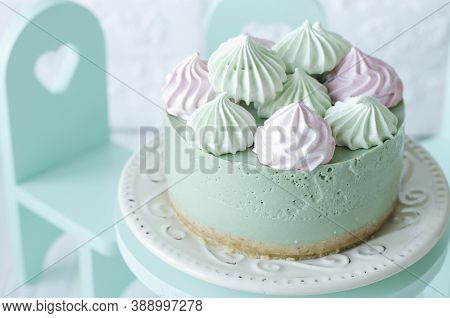 Cheesecake Without Baking With Matcha Tea On A Table