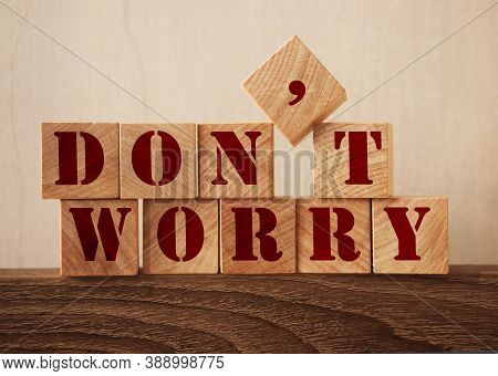 Dont Worry Text Made Of Wooden Cubes On Oak Table Edge. New Normal Concept