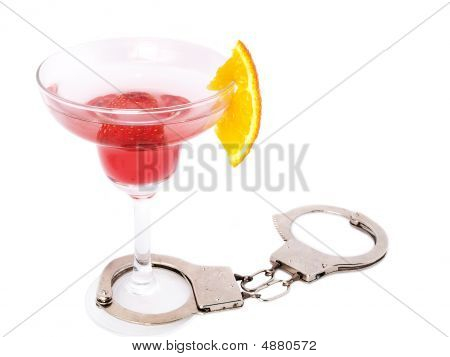 Don't Drink And Drive Concept - Cocktail Glass With Handcuffs