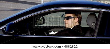 Businessman In A Luxury Car
