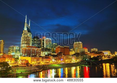 Downtown Nashville TN in the evening with colorful light reflections poster