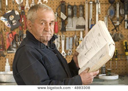 Older Mechanic Reading