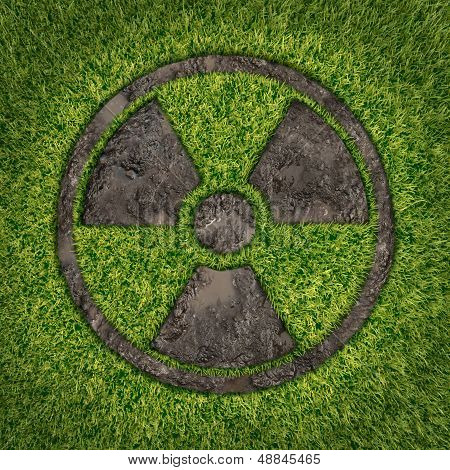 Contaminated soil concept with a green grass and the radio active symbol embosed in the ground exposing the poisoned earth as an icon of environmental disaster after a nuclear disaster and the dangerous fallout that lingers on. poster