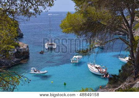 Many Tourists At The Bay Of Cala Pi In Mallorca, Spain ( Balearic Islands )