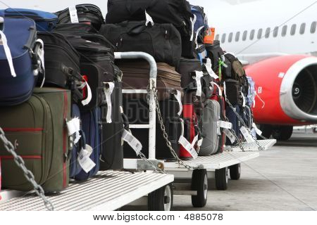 Travel Luggage Carts About To Be Taken Into The Plane's Cargo Area.